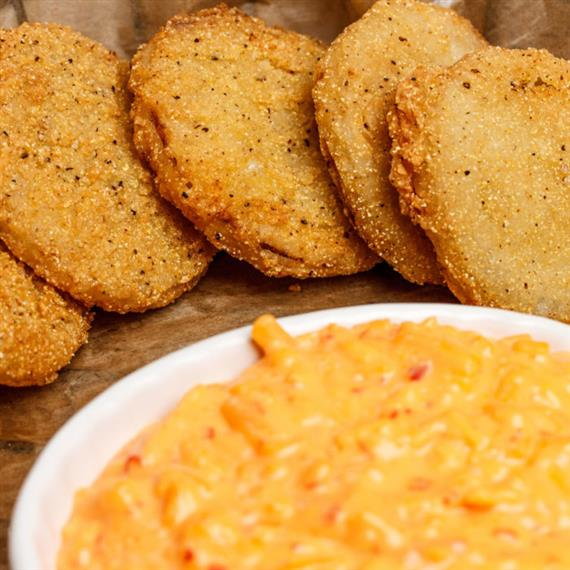 Fried Green Tomatoes: sliced & battered green tomatoes, served with a warm crock of our slightly kicked up pimento cheese