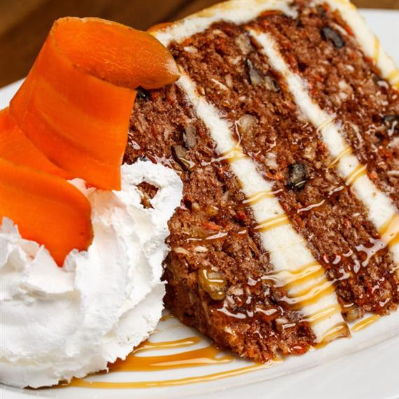 slice of carrot cake with whipped cream