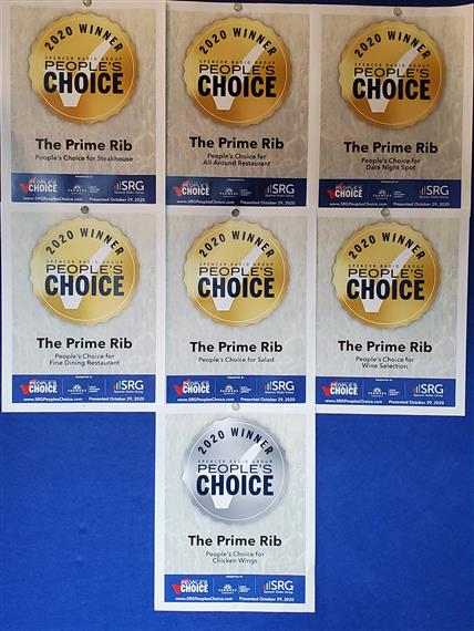 multiple people's choice awards on a wall