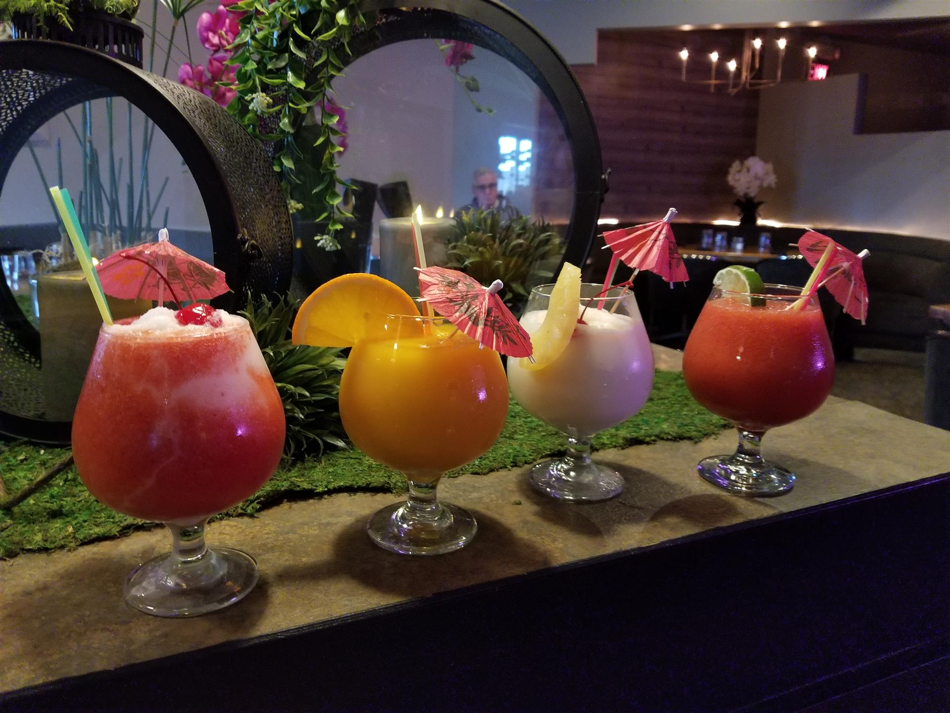 4 different kinds of daiquiris on a table