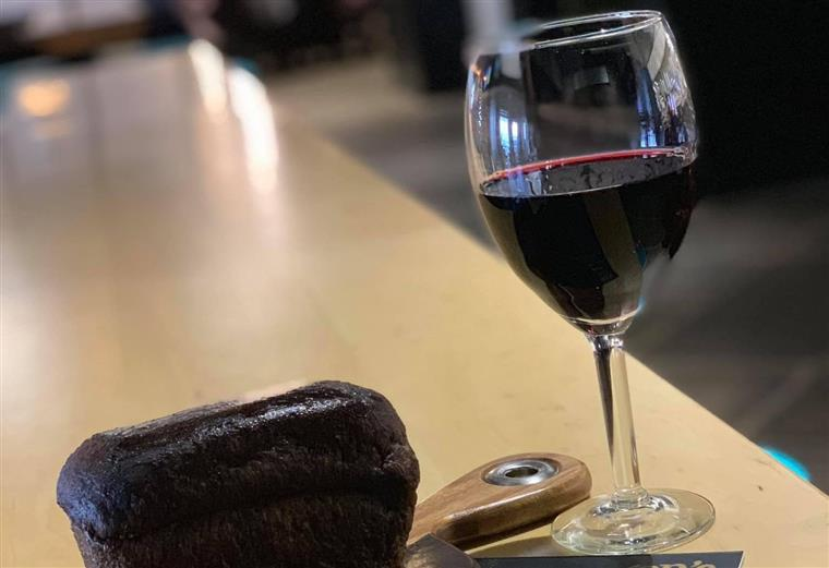 a glass of red wine and a loaf of bread