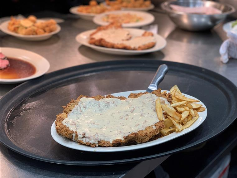 Chicken Fried Steak: A tenderized beef cutlet, served with southern cream gravy, Texas toast & French fries.