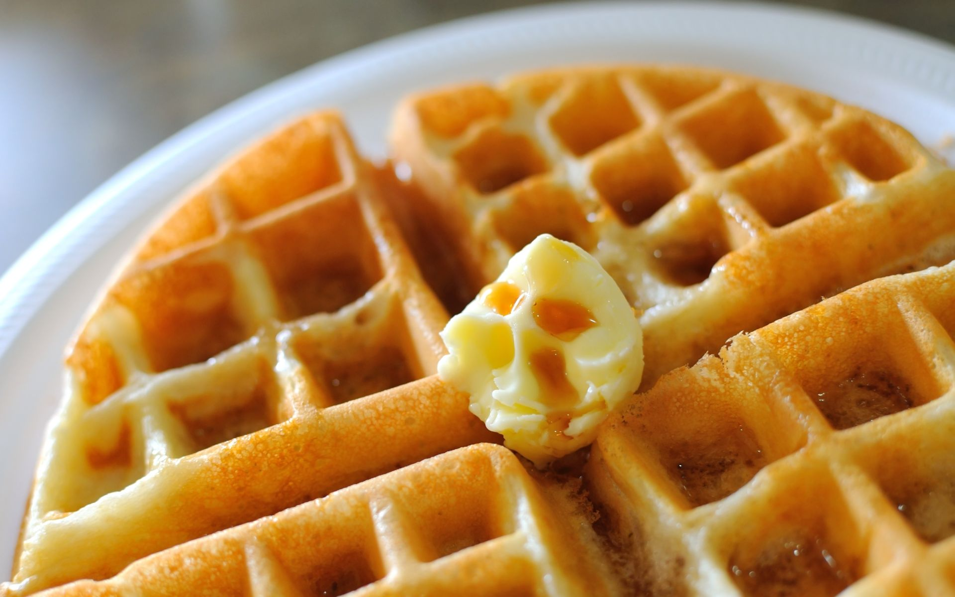 waffle with syrup and butter on a plate