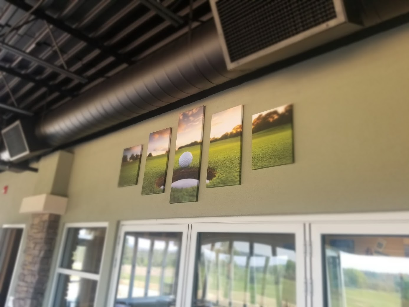 pictures of golf on the wall
