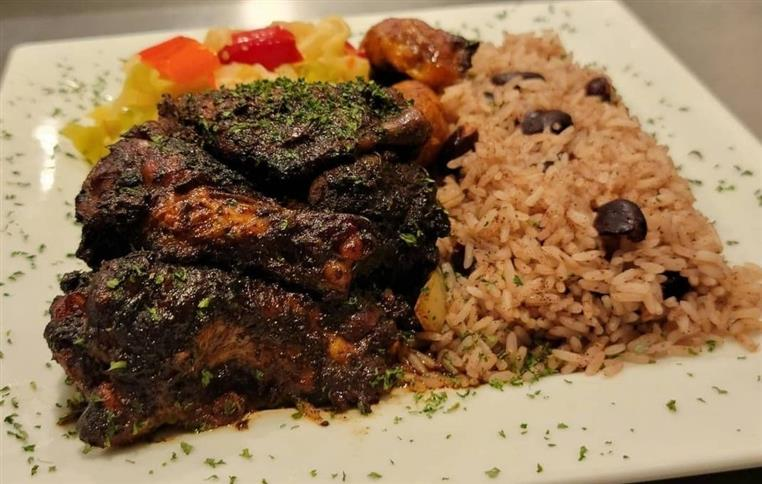 jerk wings with rice and peas with a side of mixed vegetables