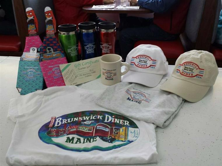 brunswick merchandise including, hats, t-shirts, mugs, coozies, and tumblers