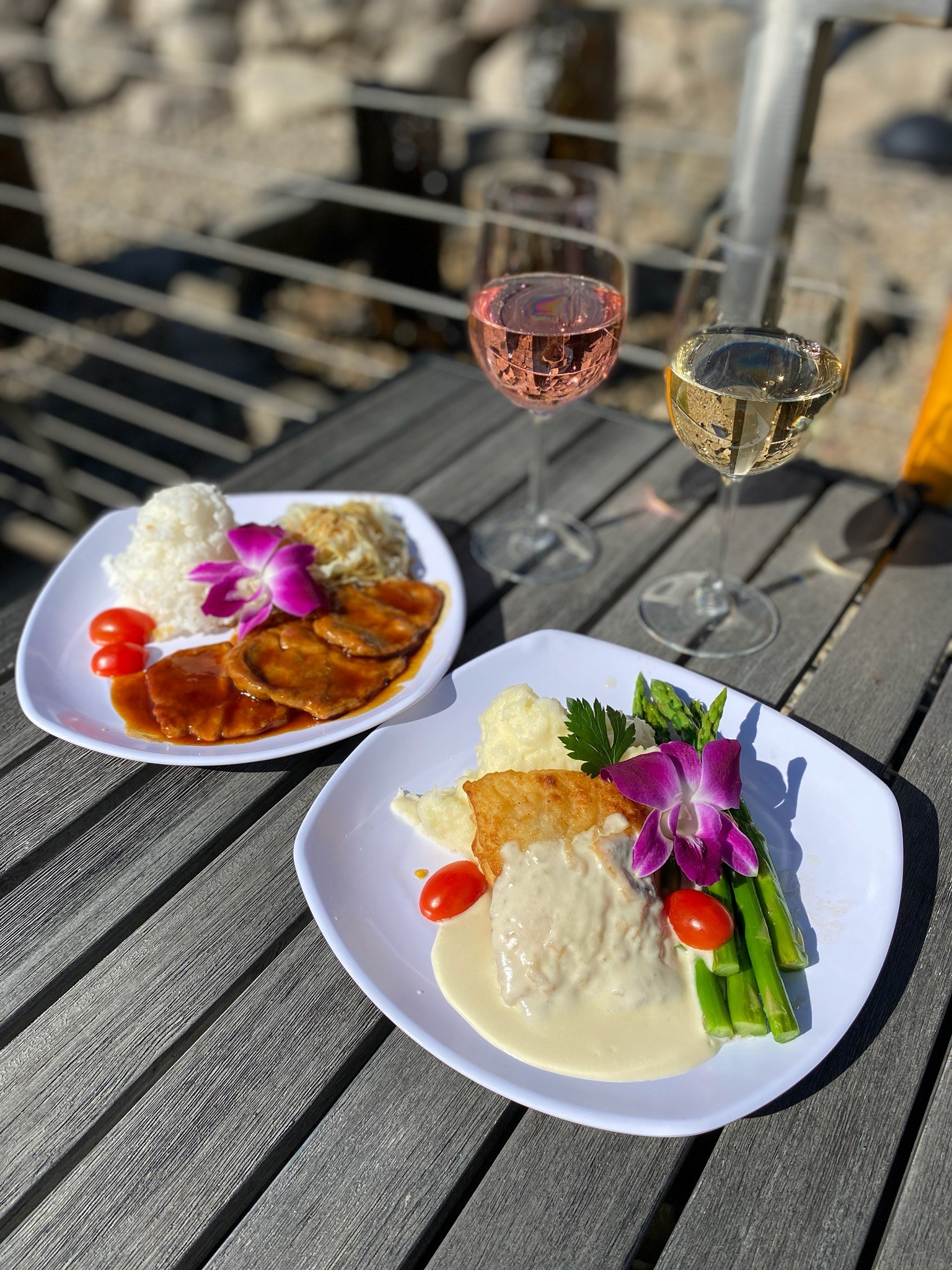 two glasses of wine paired with speciality plate and garnish