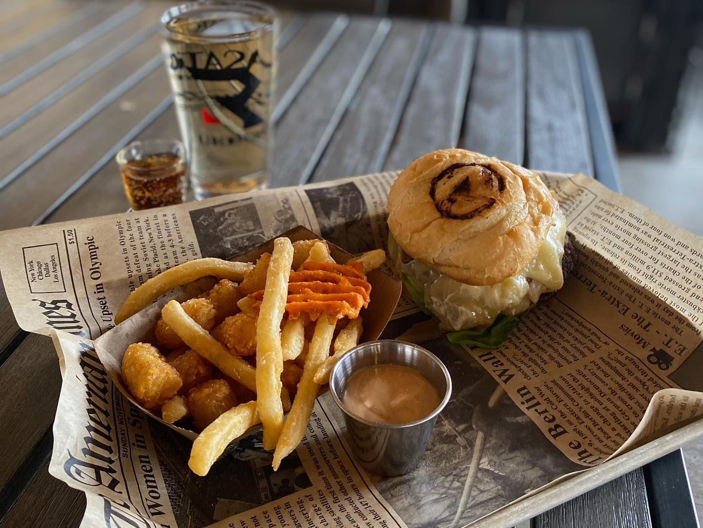 burger and fries with alcoholic drink with shot