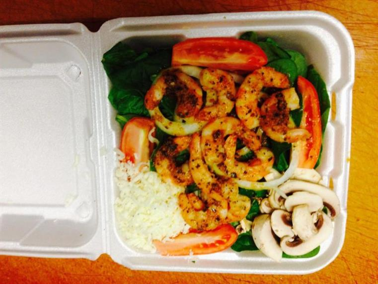 shrimp salad and rice in a takeout tray