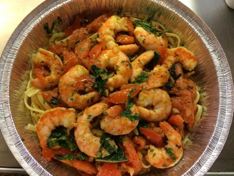shrimp and pasta in a takeout tray