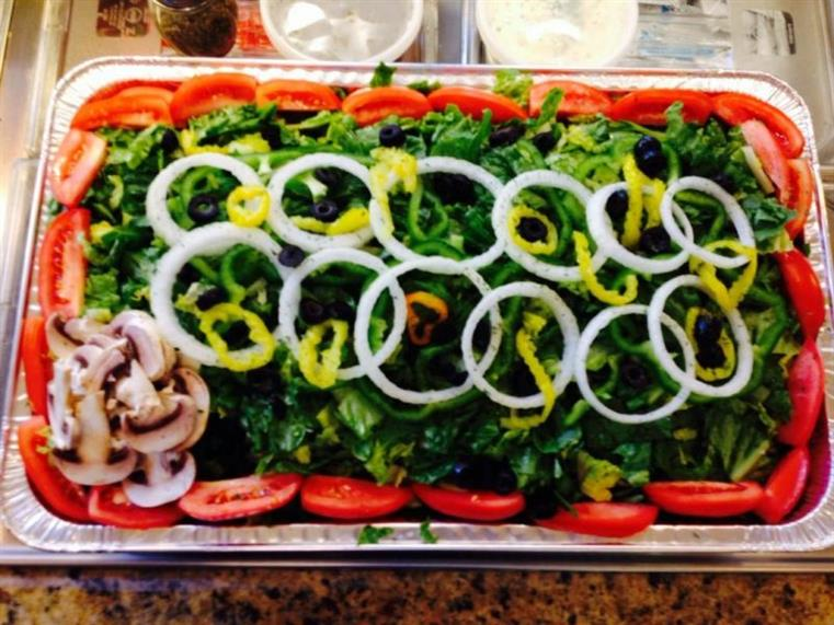 catering salad with onions, mushrooms, tomatoes, and lettuce