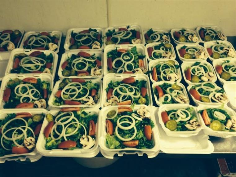 catering display of salads in takeout trays