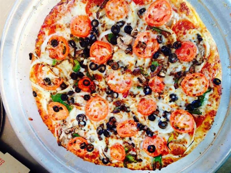 pizza with tomatoes and black olives