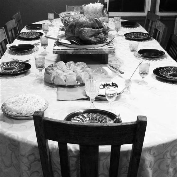 table set with plates, decor, and pie