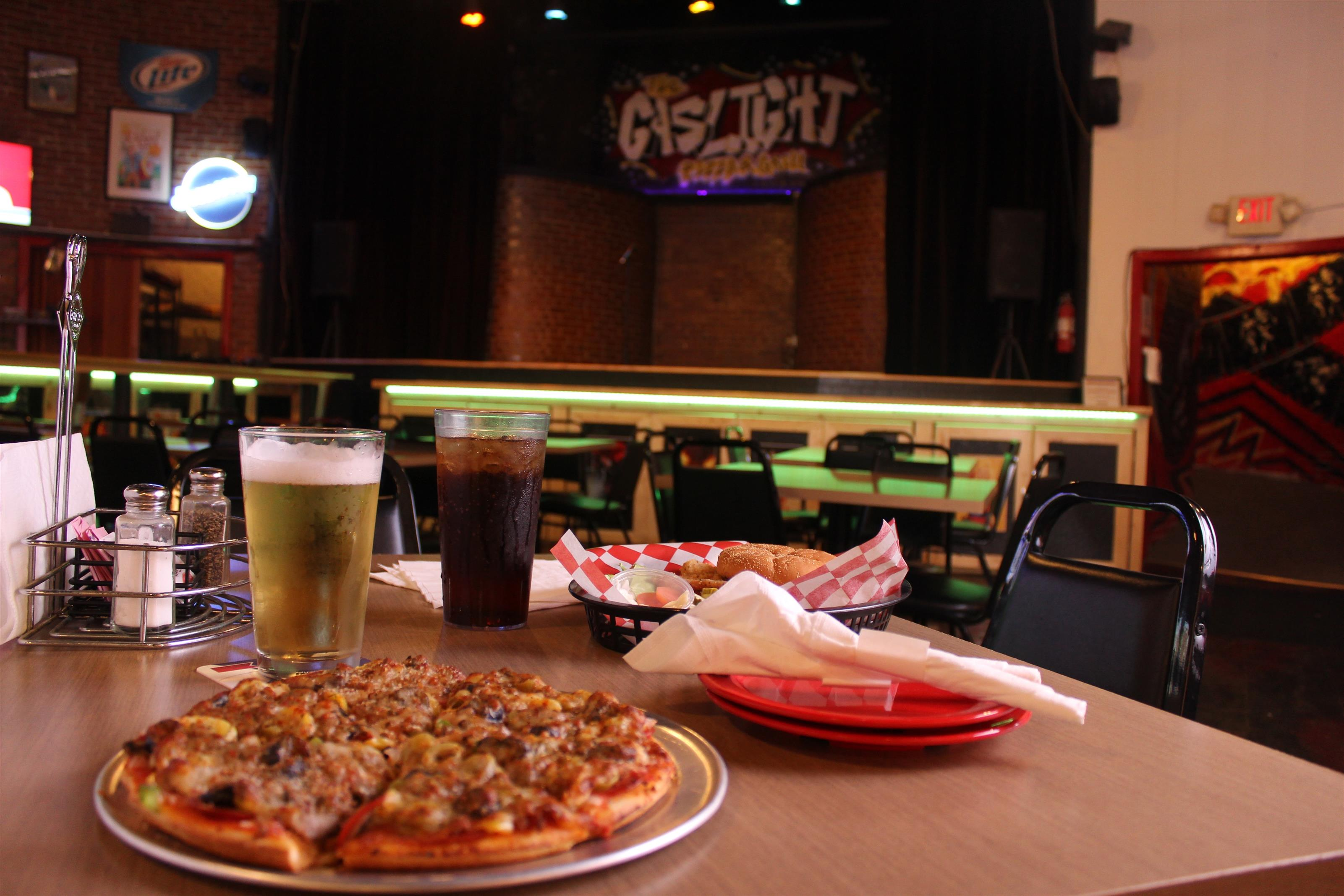 pizza pie with cola and beer with fried chicken sandwich