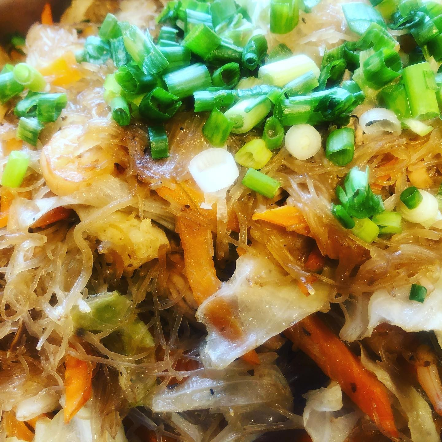 chicken and vegetables tossed with thin rice noodles