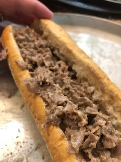 cheesesteak  on a grill