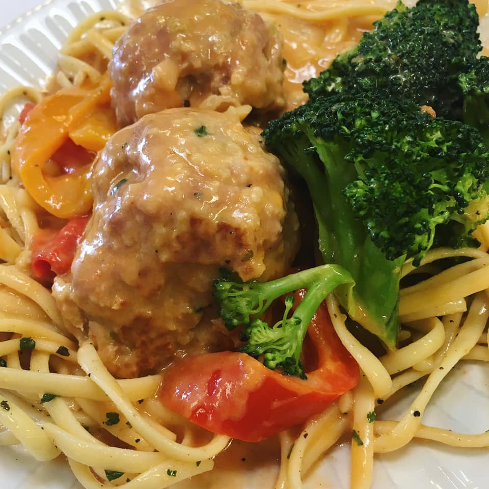 fettuccine with turkey meatballs, broccoli and peppers in a garlic parmesan sauce.