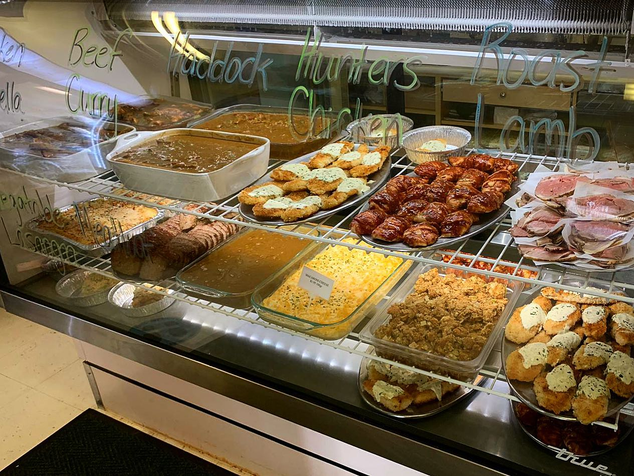 display case with assorted meals