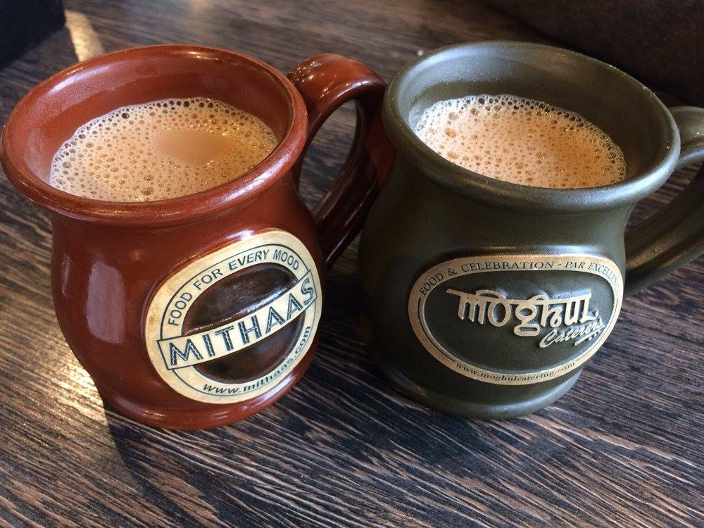 two coffee mugs on a table