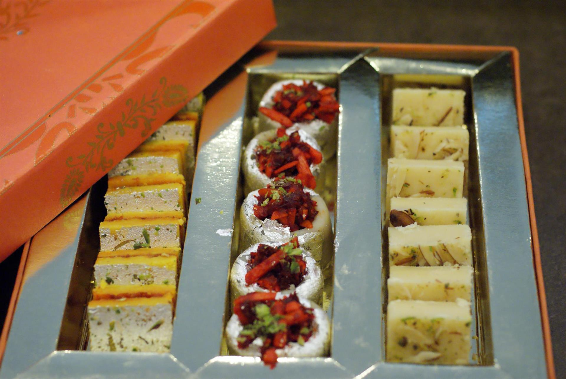 an assortment of indian sweets