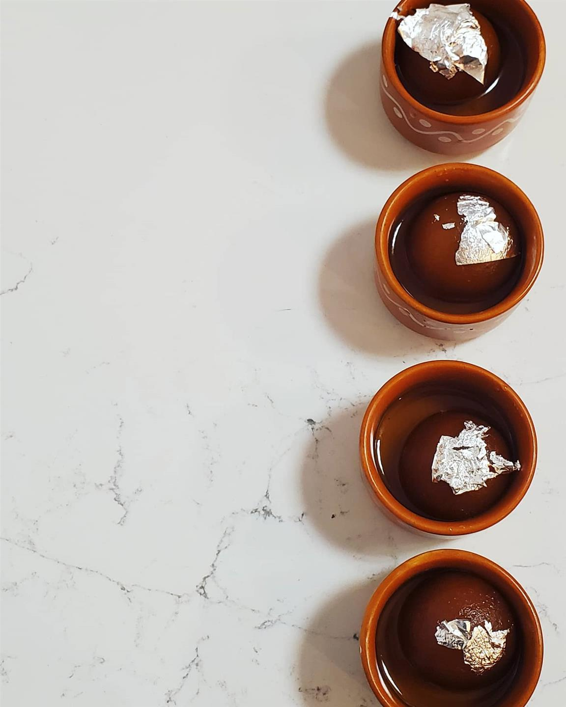 assortment of cups filled with chocolate bombs