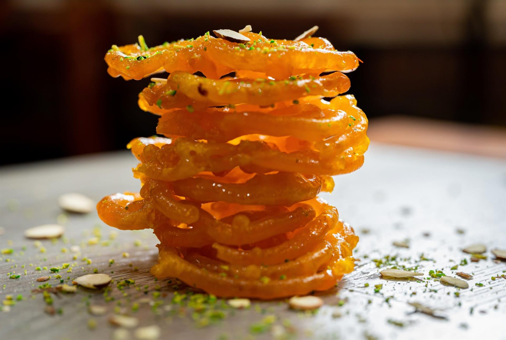 A spiral shaped crunchy sweet dipped in saffron laced sugar syrup.