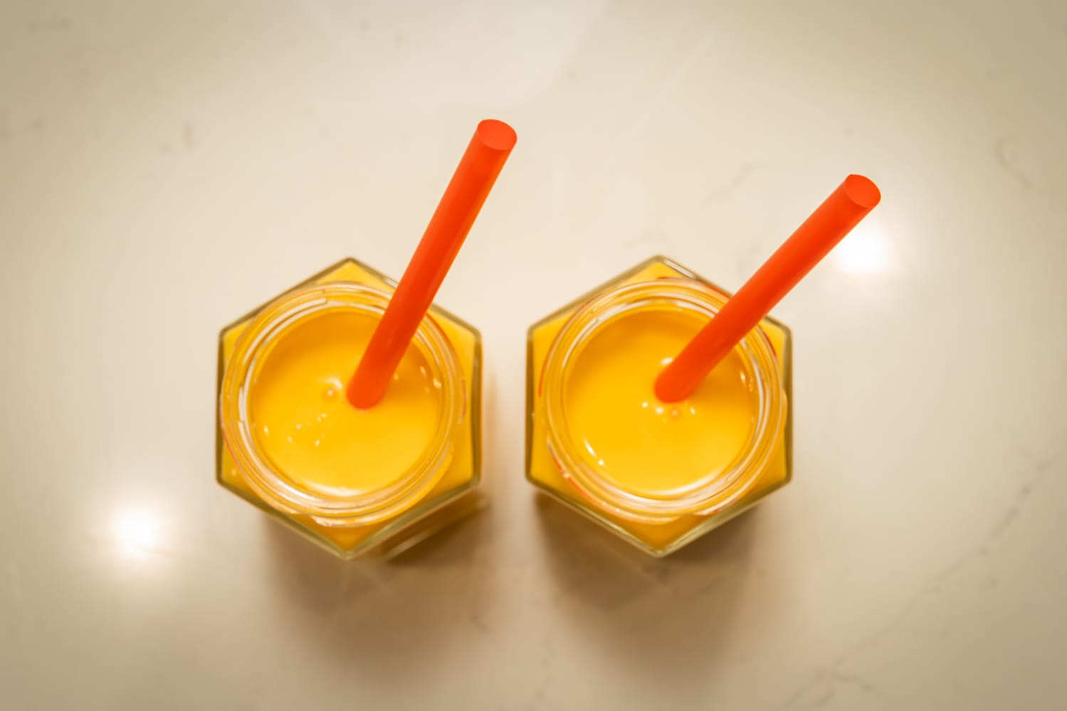 two smoothies with straws