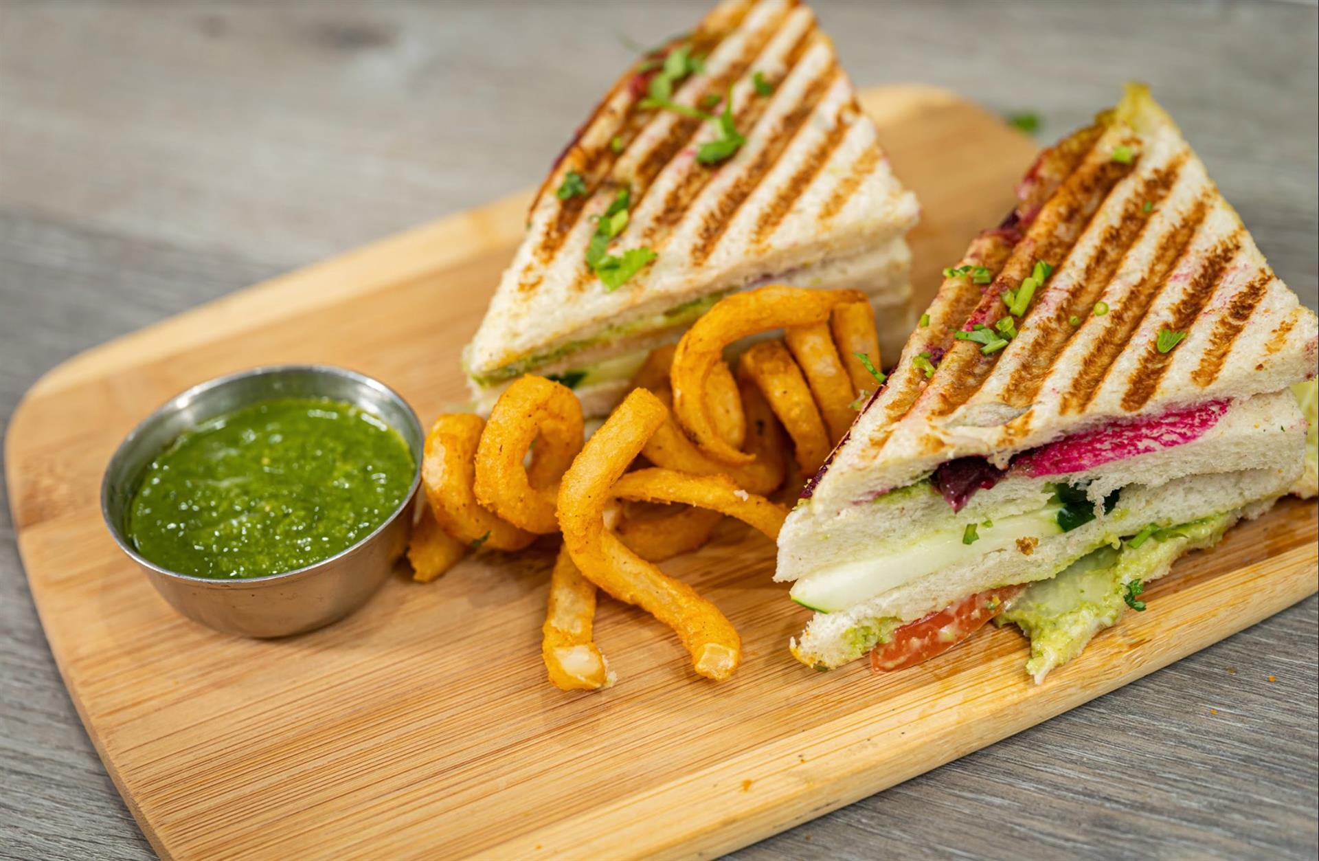 club sandwich with fries and dipping sauce
