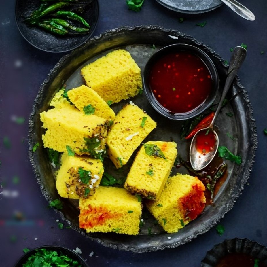 assortment of chopped Moong Dal Barfi with dipping sauce