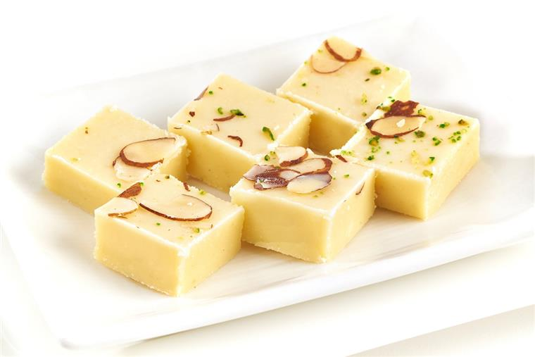 assortment of Solidified sweet milk fudge topped with slivers of almonds