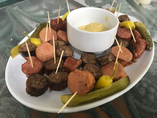 sausage platter with mustard and pickles