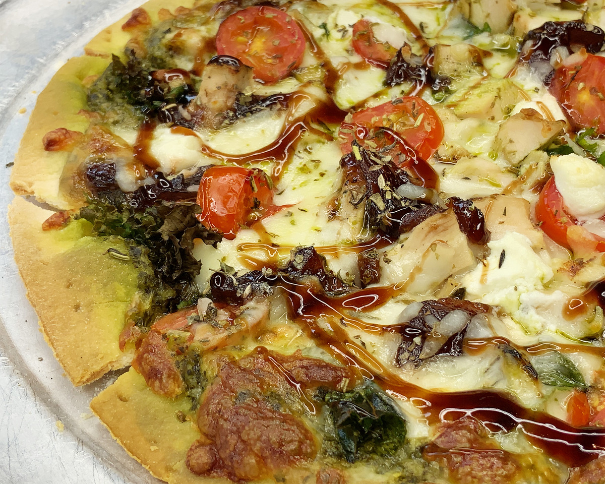 Kale Pesto Sauce - Baby Kale Blend, Chicken, Goat Cheese, Caramelized Onion Jam, Balsamic Syrup, Tomato, Mozzarella