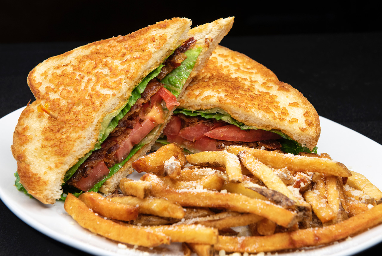 Artisan BLT. Parmesan Grilled Vienna Bread, Bacon, Lettuce, Tomato, Bacon Aioli and a side of fresh cut Parmesan/Romano fries