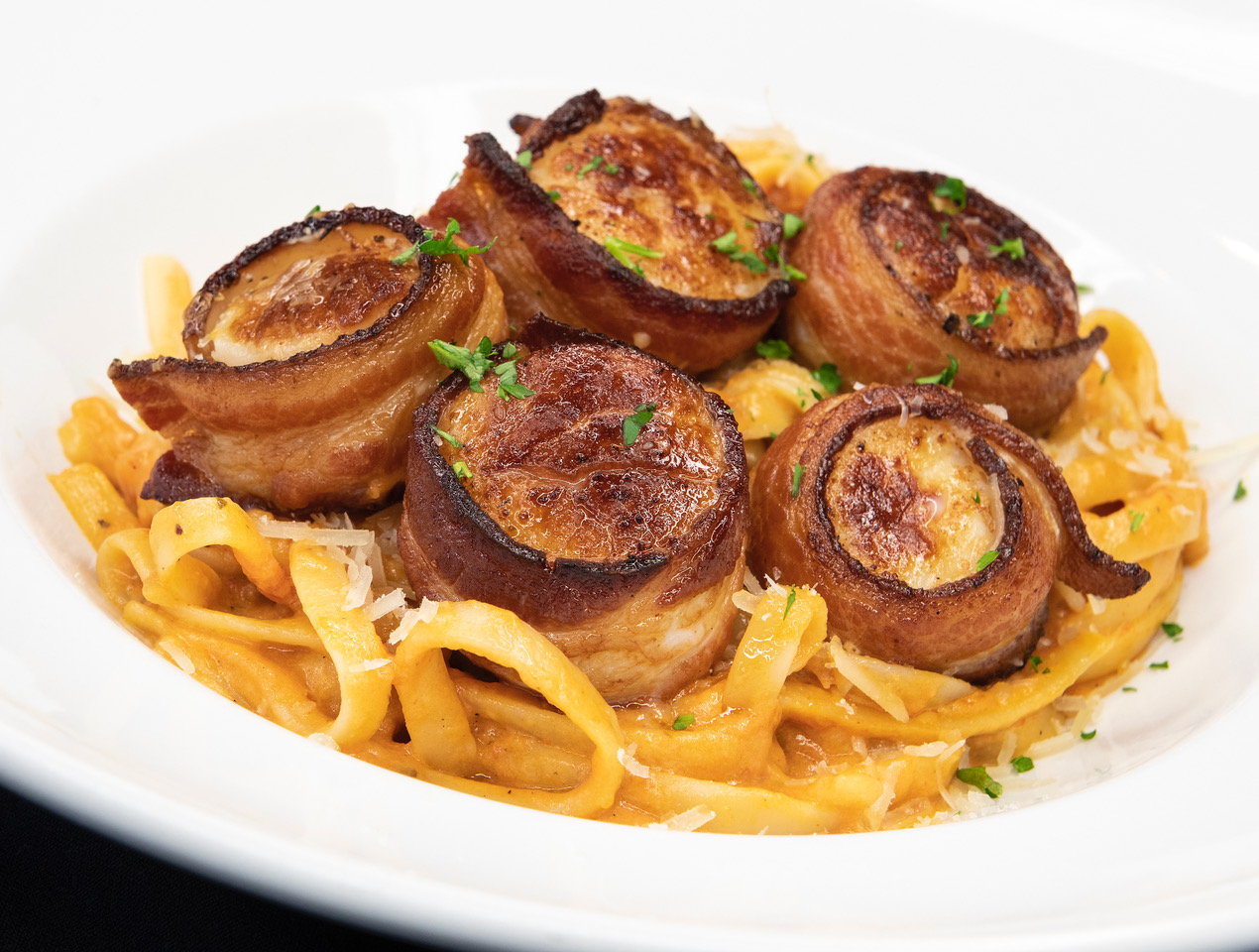Bacon Wrapped Scallops. Fettuccine and Vodka Sauce