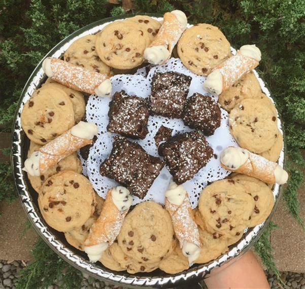Homemade chocolatechip cookies and cannolis