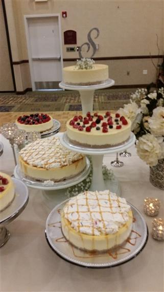 Assorted cakes on serving trays on white table