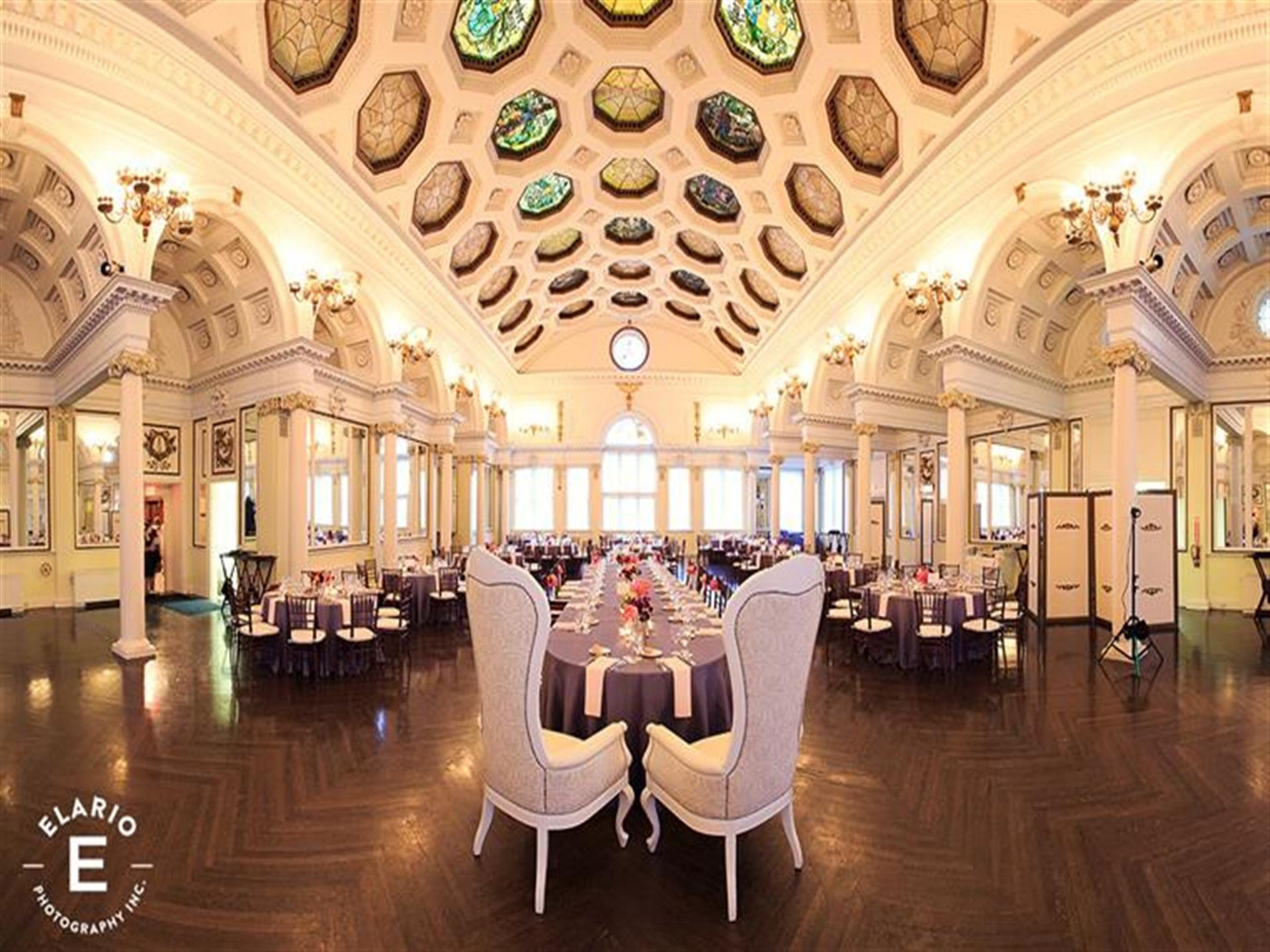 Large hall with covered dining tables and high ceilings