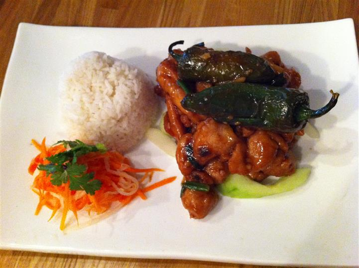 chicken served with peppers and a side of rice