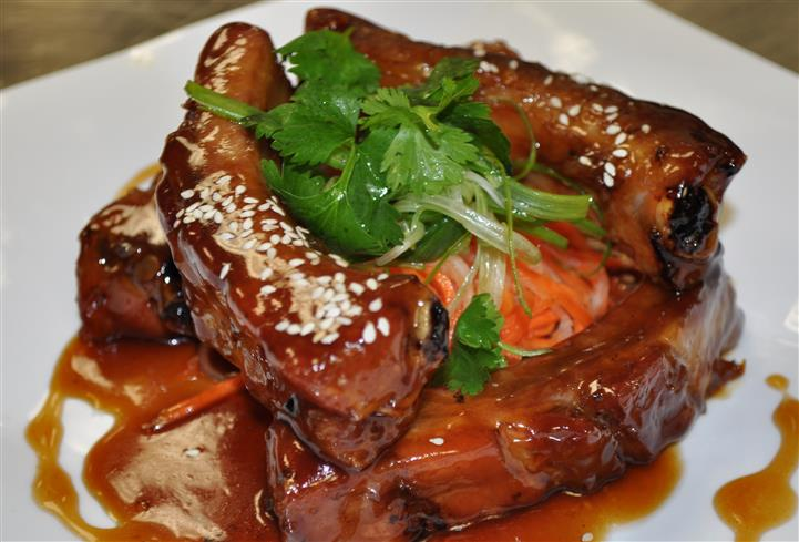 ribs with sesame sauce and garnish
