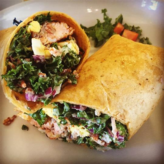 chicken wrap with kale, onions, tomatoes and cheese