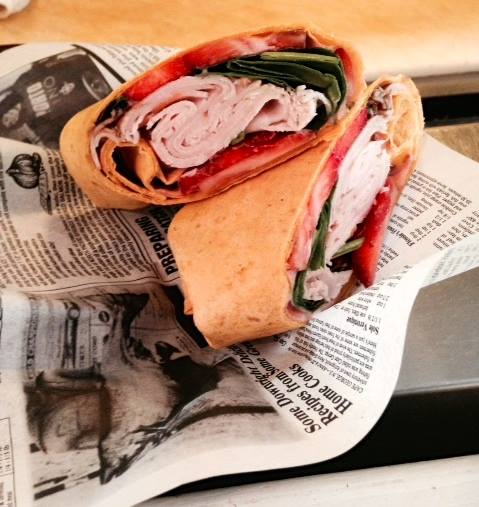 turkey club wrap with tomatoes, and spinach