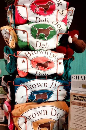 brown dog deli shirts being sold inside