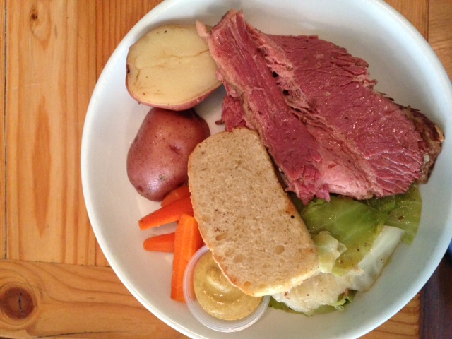 corn beef and cabbage entree with potatoes and carrots