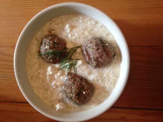 three meatballs in a bowl with creamy grits