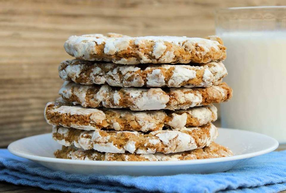 baked cookies with sugar frosting stacked together