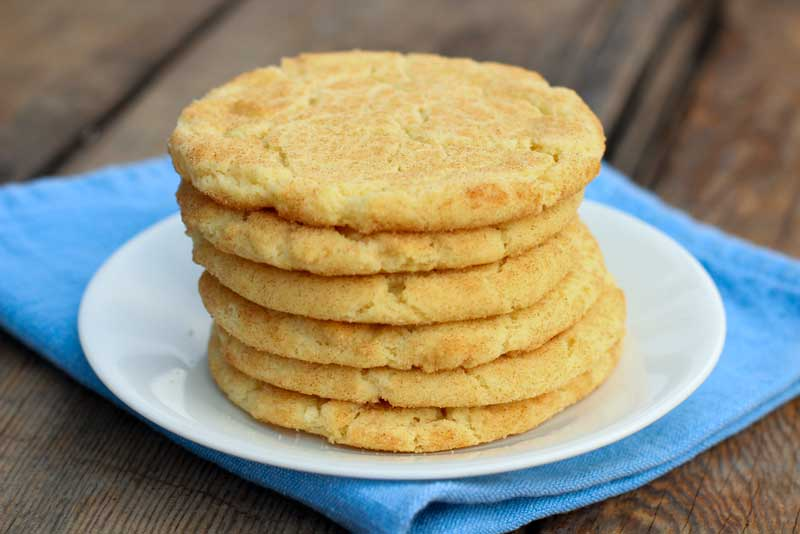 sugar cookies stacked together on a plate