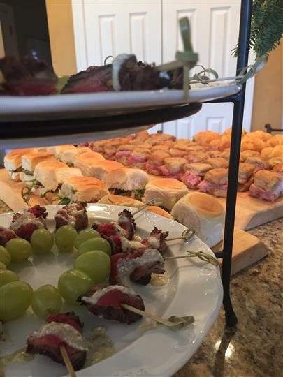 small sandwiches lined together for a buffet