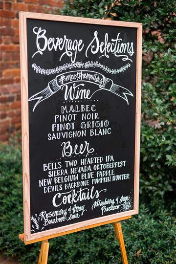 chalkboard with various drink specials and selections