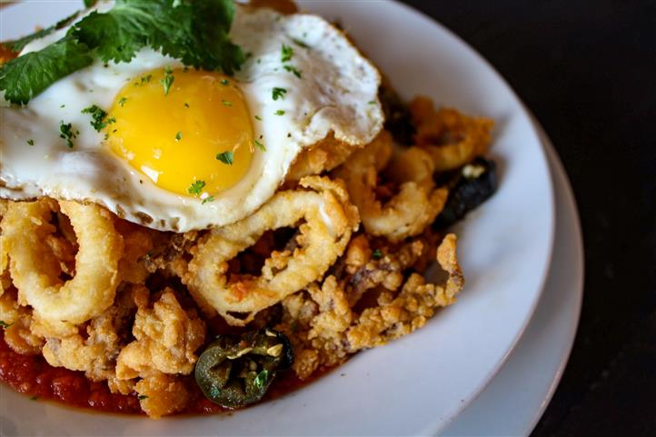 fried calamari with a fried egg on top